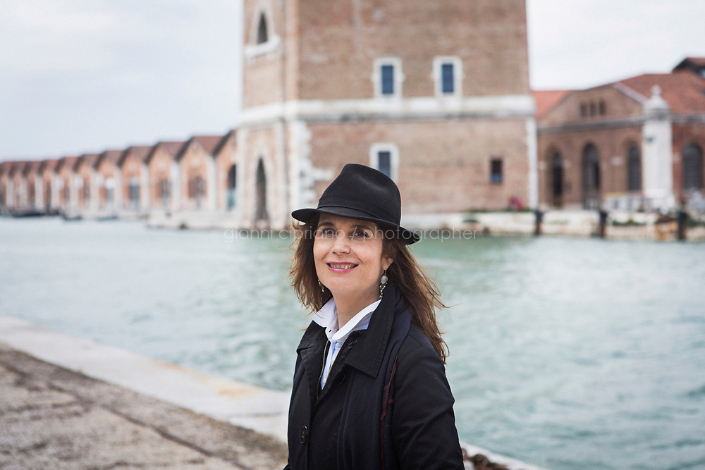 VENICE, ITALY - 1 MAY 2017: Christine Macel (49), curator of the 57th International Art Exhibition - titled VIVA ARTE VIVA - organized by La Biennale di Venezia, poses for a portrait at the Arsenale (one of the exhibition venues of the Biennale) in Venice, Italy, on May 1st 2017.<br /> <br /> The 57th International Art Exhibition, titled VIVA ARTE VIVA and curated by Christine Macel, is organized by La Biennale di Venezia chaired by Paolo Baratta. VIVA ARTE VIVA will unfold over the course of nine chapters or families of artists, beginning with two introductory realms in the Central Pavilion, followed by another seven across the Arsenale through the Giardino delle Vergini. 120 are the invited artists from 51 countries; 103 of these are participating for the first time. <br /> <br /> The Exhibition will also include 85 National Participations in the historic Pavilions at the Giardini, at the Arsenale and in the historic city centre of Venice. 3 countries will be participating for the first time: Antigua and Barbuda, Kiribati, Nigeria.