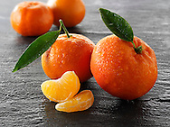 Fresh mandarins fruits with leavess.