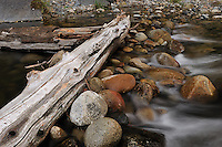 Log and Flowing Water in the Autumn on the Merced River in Yosemite Valley. Image taken with a Nikon D3 and 24-70 mm f/2.8 VR lens (ISO 200, 52 mm, f/16, 2.6 sec).