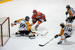 Toni Dahlman of Jesenice vs Fabian Weinhandl and Patrick Harand of Graz during ice hockey match between HK Acroni Jesenice and  Moser Medical Graz 99ers in 24th Round of EBEL league, on December 3, 2010 in Arena Podmezakla, Jesenice, Slovenia.  (Photo By Vid Ponikvar / Sportida.com)