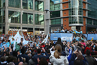 Football - Premier League - Manchester City Premier League Trophy Parade<br /> Manchester City fans surround the parade bus as it makes it's way through Manchester