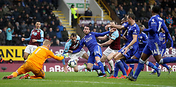 Burnley's Peter Crouch (left) and Leicester City's Christian Fuchs battle for the ball as Leicester City goalkeeper Kasper Schmeichel (left) dives for the ball during the Premier League match at Turf Moor, Burnley.