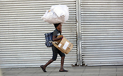South Africa - Durban - 06 May 2020 - A homeless person walk pass by on during level 4 lockdown on Gale street in Durban. Picture: Bongani Mbatha/African News Agency(ANA)