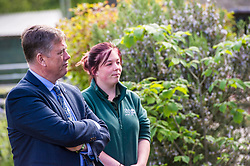 Pictured: Keith Brown and Maia Gordon<br /> <br /> Cabinet Secretary for Economy, Jobs & Fair Work Keith Brown visited Gorgie City Farm today  to mark their accreditation as the 800th Living Wage employer in Scotland. Mr Brown met Josiah Lockhart, CEO and undertook a short tour of the farm, celebrating their accreditation and promoting the Living Wage more generally. The Scottish Government has set a target of reaching 1,000 Scottish-based Living Wage Accredited Employers by autumn 2017. While at the farm Mr Brown met Maia Gordon, Kirsty McGoff (17) and Zoe White (18), who have benefited from the living wage, and George Ellis, chair of the farm's board of directors<br /> Ger Harley | EEm 18 May 2017