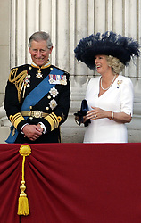 File photo dated 10/07/05 of the Prince of Wales and the Duchess of Cornwall watching the fly-past on the balcony at Buckingham Palace. Charles and Camilla are celebrating their 15th wedding anniversary on Friday, after they were reunited on Monday when the 72-year-old duchess came out of a 14-day self-isolation on the Balmoral estate in Aberdeenshire.