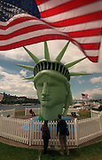 Spectators get a close-up view of the inflatable Statue of Liberty at Gas Works Park.<br />