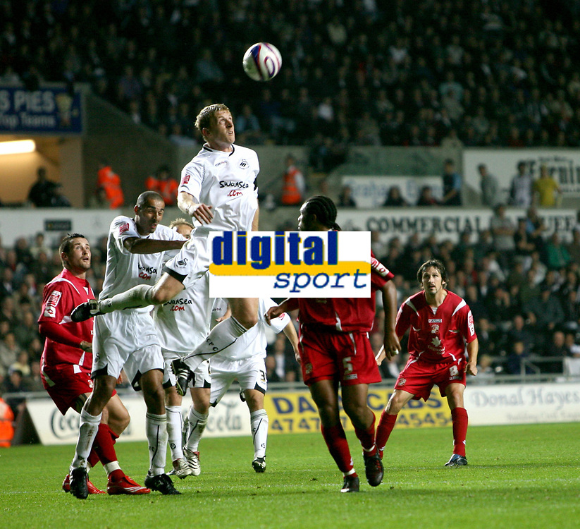 Photo: James Davies.<br />Swansea City v Swindon Town. Coca Cola League 1. 02/10/2007. <br />Swansea`s Garry Monk clears ball over Jerel Ifil.