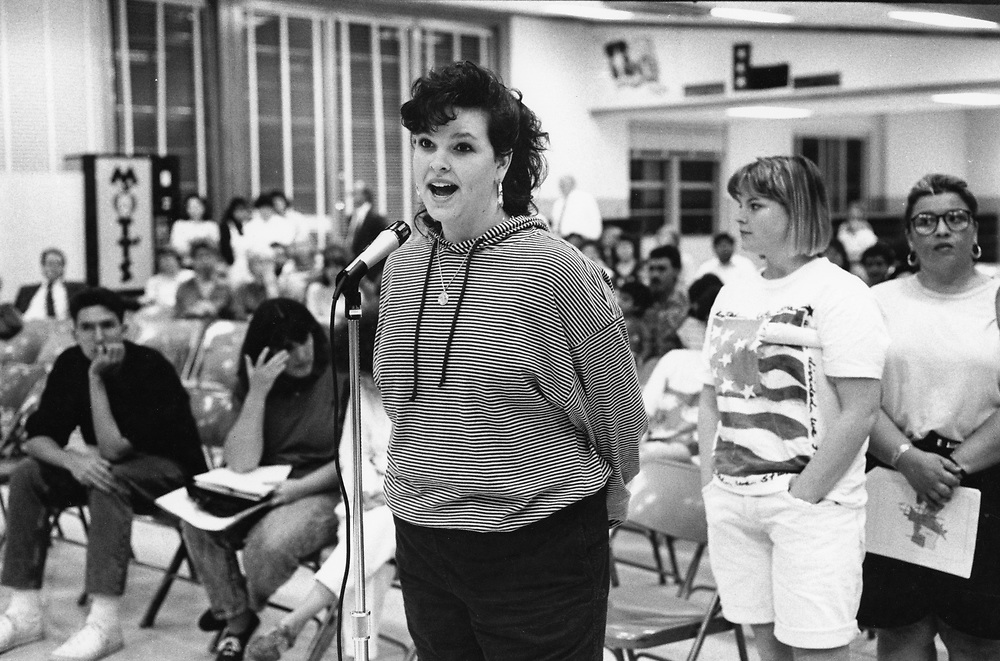 ©1991 STUDENT SPEAKING OUT: at public meeting regarding the closing of he high school,  Travis High, Austin, Texas.