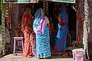 Indian women shopping, street scene Tambaku Bazar in Jodhpur Old Town, Rajasthan, Northern India