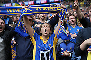 AFC Wimbledon fans celebrate after the final whistle. Skybet football league two play off final match, AFC Wimbledon v Plymouth Argyle at Wembley Stadium in London on Monday 30th May 2016.<br /> pic by John Patrick Fletcher, Andrew Orchard sports photography.