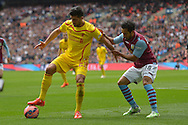 Emre Can of Liverpool shields the ball from Kieran Richardson of Aston Villa. The FA Cup, semi final match, Aston Villa v Liverpool at Wembley Stadium in London on Sunday 19th April 2015.<br /> pic by John Patrick Fletcher, Andrew Orchard sports photography.