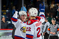 KELOWNA, BC - NOVEMBER 26:  Matthew Robertson #22 of the Edmonton Oil Kings high fives a teammate to celebrate the win against the Kelowna Rockets at Prospera Place on November 26, 2019 in Kelowna, Canada. (Photo by Marissa Baecker/Shoot the Breeze)