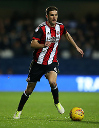"""Sheffield United's Chris Basham in action during the game during the Sky Bet Championship match at Loftus Road, London. PRESS ASSOCIATION Photo. Picture date: Tuesday October 31, 2017. See PA story SOCCER QPR. Photo credit should read: Steven Paston/PA Wire. RESTRICTIONS: EDITORIAL USE ONLY No use with unauthorised audio, video, data, fixture lists, club/league logos or """"live"""" services. Online in-match use limited to 75 images, no video emulation. No use in betting, games or single club/league/player publications."""