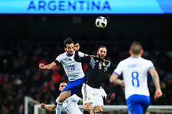 Marco Parolo of Italy challenges for a header with Gonzalo Higuain of Argentina - Mandatory by-line: Matt McNulty/JMP - 23/03/2018 - FOOTBALL - Etihad Stadium - Manchester, England - Argentina v Italy - International Friendly