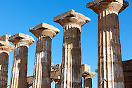 Greek Dorik columns at the  ruins of Temple F at Selinunte, Sicily photography, pictures, photos, images & fotos. 68 .<br /> <br /> If you prefer to buy from our ALAMY PHOTO LIBRARY  Collection visit : https://www.alamy.com/portfolio/paul-williams-funkystock/selinuntetemple.html<br /> Visit our CLASSICAL WORLD HISTORIC SITES PHOTO COLLECTIONS for more photos to buy as buy as wall art prints https://funkystock.photoshelter.com/gallery-collection/Classical-Era-Historic-Sites-Archaeological-Sites-Pictures-Images/C0000g4bSGiDL9rw