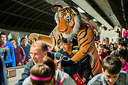 Paul Goldstein joins other competitors taking the tube and the train with an 8ft tiger which he will run with in order to raise money for tiger projects in India. Every picture/sighting of Paul sent in to exodus.co.uk will generate £2 in sponsorship from Opticron. The London Marathon starts in Greenwich on Blackheath passes through Canary Wharf and finishes in the Mall. London UK, 13 April 2014.  Guy Bell, 07771 786236 guy@gbphotos.com