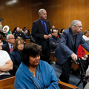 Nick Cavazos, left, who was born after the death of his aunt, Irene Garza, glares at John Feit with his arms crossed during the trial. Although Cavazos never met his aunt, he was angry about the impact Garza's murder had on his family, especially his mother. Nathan Lambrecht/The Monitor