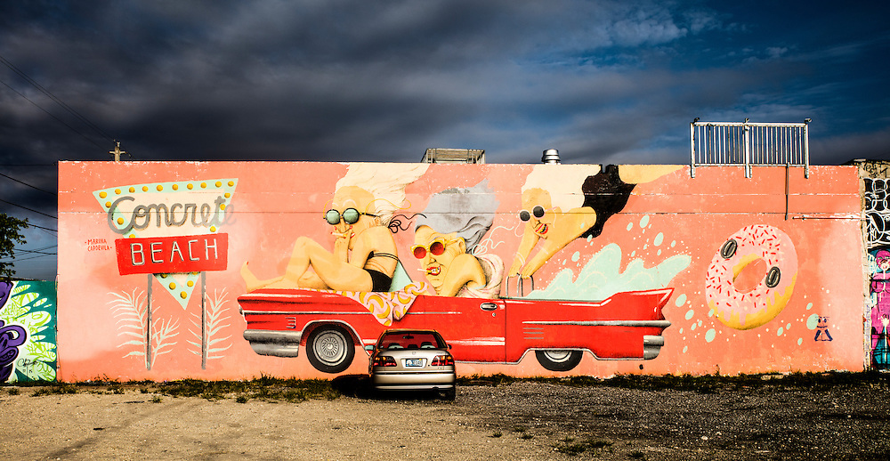 Mural in Wynwood by Barcelona-based Marina Capdevila features a coral pink Cadillac convertible