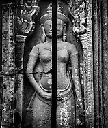 Bas-relief on a temple wall split down the middle, Angkor, Siem Reap, Cambodia, 2005, Southeast Asia