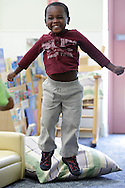 Errol McKinson jumps during a sing-along at the Sullivan County Early Head Start program in Woodbourne on Tuesday, July 23, 2013.