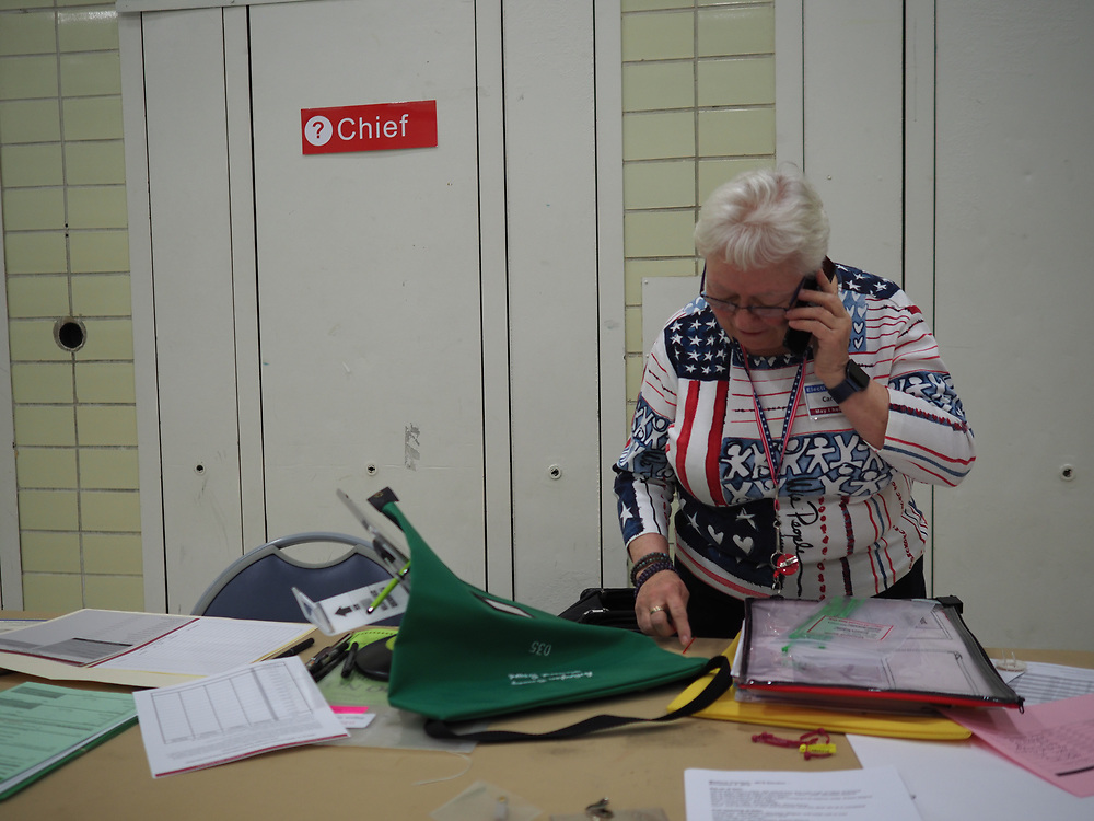 An Arlington, VA election chief prepares to open the polls on Presidential Primary Day.