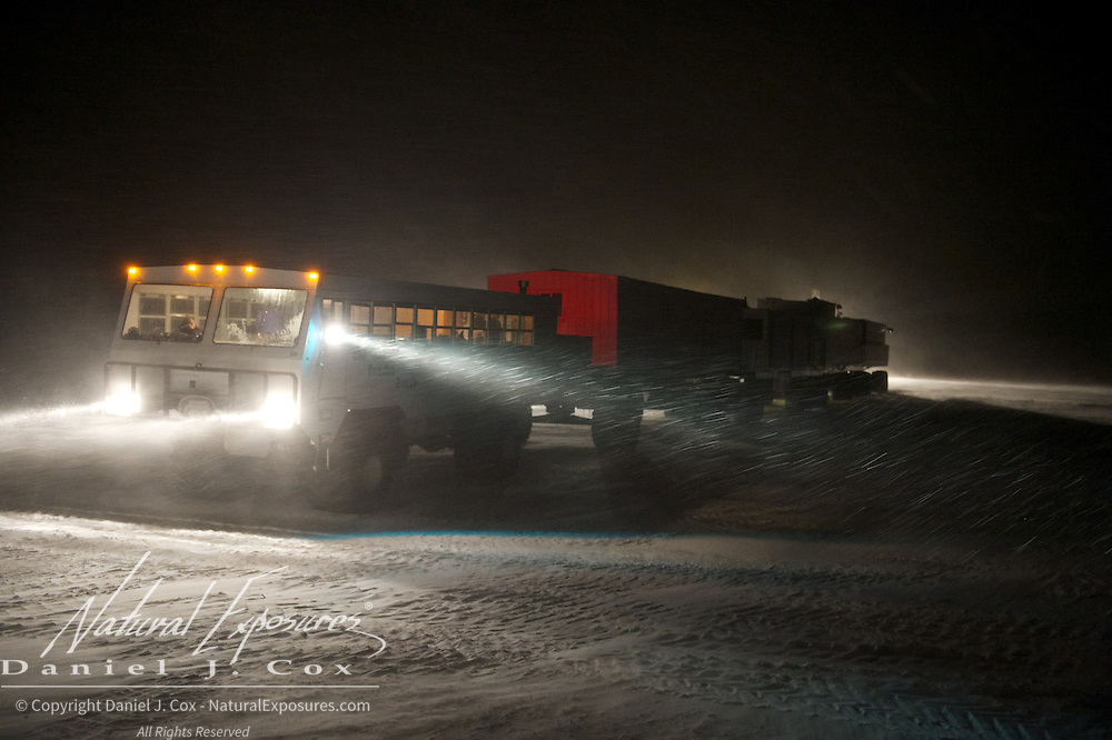 The Tundra Buggy crew works to reassemble the lodge after a long day of travel to CApe Churchill, Hudson Bay, Manitoba.