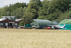 © Licensed to London News Pictures. 04/07/2015. <br /> Pictured: Other airfield at the site remain grounded.<br /> Two men have been killed in a Microlight crash at Enstone Airfield in Oxfordshire. Photo credit should read Max Bryan/LNP
