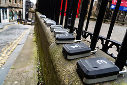 Short term letting key safes attached to railings in Old Town of Edinburgh, Scotland , UK