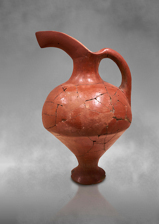 Hittite terra cotta red glazed beak spout pitcher . Hittite Period, 1600 - 1200 BC. Çorum Archaeological Museum, Corum, Turkey. Against a grey bacground. .<br />  <br /> If you prefer to buy from our ALAMY STOCK LIBRARY page at https://www.alamy.com/portfolio/paul-williams-funkystock/hittite-art-antiquities.html  - Hattusa into the LOWER SEARCH WITHIN GALLERY box. Refine search by adding background colour, place,etc<br /> <br /> Visit our HITTITE PHOTO COLLECTIONS for more photos to download or buy as wall art prints https://funkystock.photoshelter.com/gallery-collection/The-Hittites-Art-Artefacts-Antiquities-Historic-Sites-Pictures-Images-of/C0000NUBSMhSc3Oo