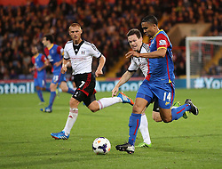 Crystal Palace's Jerome Thomas under pressure from Fulham's Sascha Rieter - Photo mandatory by-line: Robin White/JMP - Tel: Mobile: 07966 386802 21/10/2013 - SPORT - FOOTBALL - Selhurst Park - London - Crystal Palace V Fulham - Barclays Premier League