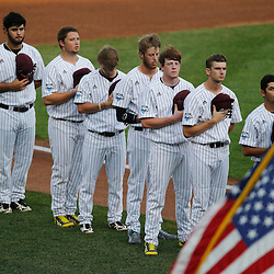 Jun 24, 2013; Omaha, NE, USA; Mississippi State Bulldogs players stand for the national anthem before game 1 of the College World Series finals against the UCLA Bruins at TD Ameritrade Park. Mandatory Credit: Derick E. Hingle-USA TODAY Sports