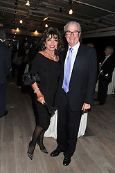 JOAN COLLINS and LORD BELL at a party to celebrate the publication of her  autobiography - The World According to Joan, held at the British Film Institute, South Bank, London SE1 on 8th September 2011.