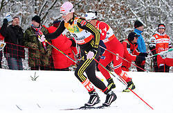 Marit Bjoergen of Norway and Evi Stehle Sachenbacher (L) of Germany at Ladies` Pursuit 7,5 km Classic + 7,5 km Free at FIS Nordic World Ski Championships Liberec 2008, on February 21, 2009, in Vestec, Liberec, Czech Republic. (Photo by Vid Ponikvar / Sportida)