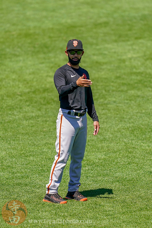 July 5, 2020; San Francisco, California, United States; San Francisco Giants bench coach Kai Correa (50) instructs while wearing a face mask during a Spring Training workout at Oracle Park.
