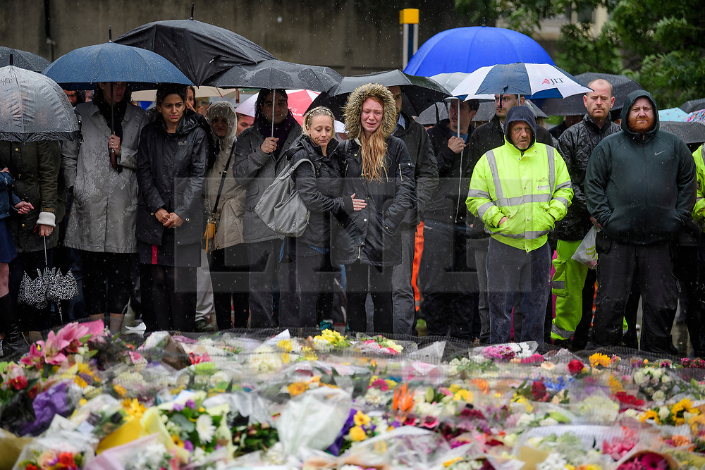 © Licensed to London News Pictures. 06/06/2017. London, UK.  Nicola Smith (centre) the ex-girlfriend of attack victim James McMullan, is comforted by her sister during a minutes silence at London Bridge in central London for those who lost their life in a terrorist attack on Saturday evening. Three men attacked members of the public  after a white van rammed pedestrians on London Bridge.   Ten people including the three suspected attackers were killed and 48 injured in the attack. Photo credit: Ben Cawthra/LNP