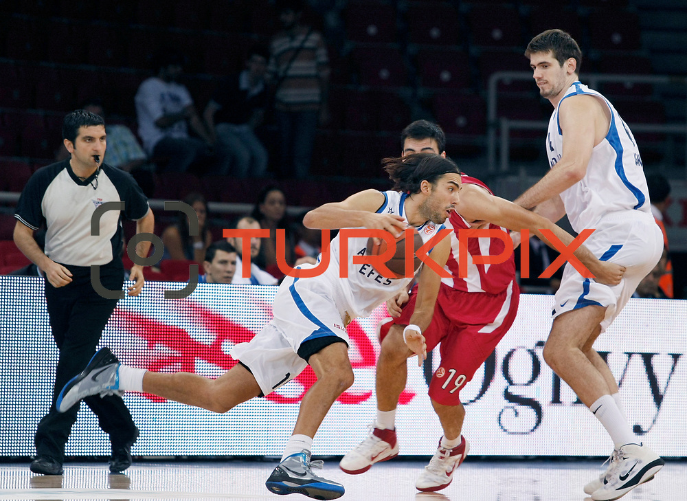 Anadolu Efes's Sasha VUJACIC (C) during their Two Nations Cup basketball match Anadolu Efes between Olympiacos at Abdi Ipekci Arena in Istanbul Turkey on Sunday 02 October 2011. Photo by TURKPIX