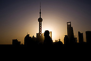 Shanghai's skyline at dawn with The Oriental Pearl TV Tower landmark in shadow puppet. China, Asia.