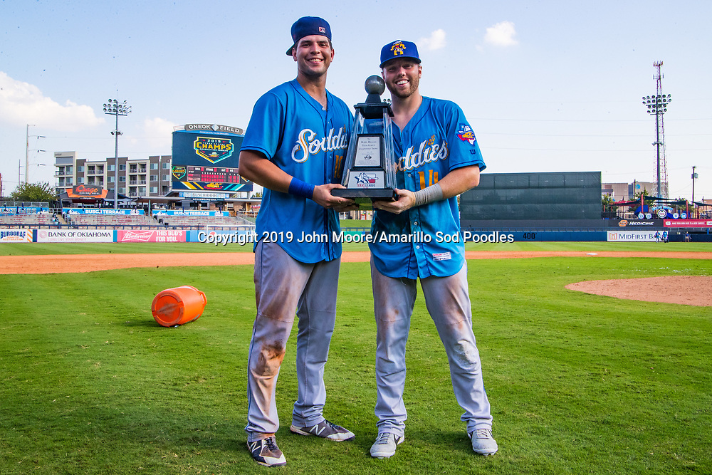 Amarillo Sod Poodles infielder Hudson Potts (10) and Amarillo Sod Poodles infielder Owen Miller (14) poses with the trophy after the Sod Poodles won against the Tulsa Drillers during the Texas League Championship on Sunday, Sept. 15, 2019, at OneOK Field in Tulsa, Oklahoma. [Photo by John Moore/Amarillo Sod Poodles]