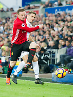 Football - 2016 / 2017 Premier League - Swansea City vs. Manchester United<br /> <br /> Wayne Rooney, captain, of Manchester Utd challenged by Angel Rangel of Swansea at the Liberty Stadium.<br /> <br /> COLORSPORT/WINSTON BYNORTH