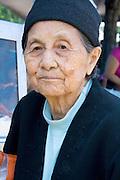 Peaceful face of an elderly Hmong woman. Hmong Sports Festival McMurray Field St Paul Minnesota USA