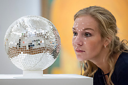 "© Licensed to London News Pictures. 20/10/2017. London, UK. A staff member views ""Mirror Ball"" by Monit Farmanfarmaian, (GBP35-45k), at a preview of Islamic, Middle Eastern and other artworks which be auctioned at Sotheby's New Bond Street on 24 and 25 October. Photo credit : Stephen Chung/LNP"