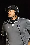 Raider head coach Todd Ford watches the Raiders play against Westwood Friday at Dragon Stadium.  (LOURDES M SHOAF for Statesman.)