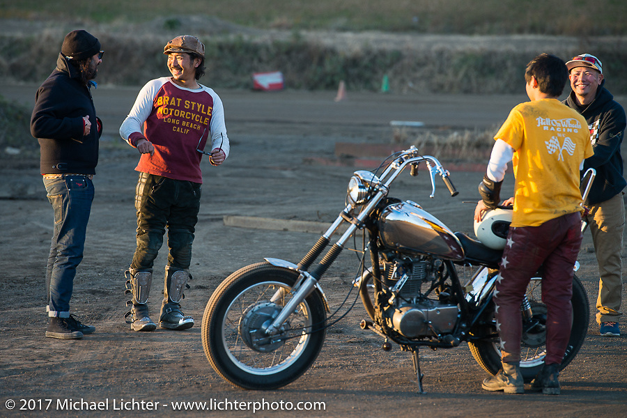 Go Takamine chats with David Borras his Brat Style's flat track racing at West Point Offroad Village. Kawagoe, Saitama. Japan. Wednesday December 6, 2017. Photography ©2017 Michael Lichter.