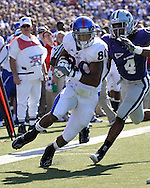 MANHATTAN, KS - NOVEMBER 07:  Wide receiver Dezmon Briscoe #80 of the Kansas Jayhawks rushes past defender Joshua Moore #4 of the Kansas State Wildcats en route to a 17-yard touchdown in the second quarter on November 7, 2009 at Bill Snyder Family Stadium in Manhattan, Kansas.  (Photo by Peter G. Aiken/Getty Images)