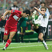 Turkey's Arda TURAN (L) and Germany's Philipp LAHM (R) during their UEFA EURO 2012 Qualifying round Group A matchday 19 soccer match Turkey betwen Germany at TT Arena in Istanbul October 7, 2011. Photo by TURKPIX
