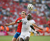 Photo: Chris Ratcliffe.<br /> Czech Republic v Ghana. Group E, FIFA World Cup 2006. 17/06/2006.<br /> Stephen Appia of Ghana clashes with Libor Sionko of the Czech Republic.