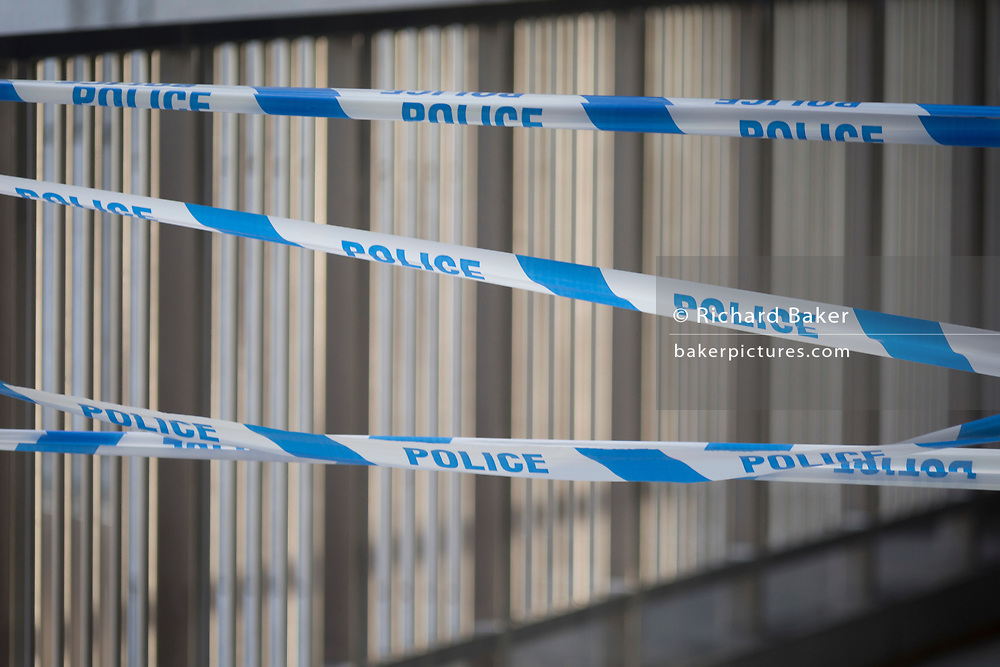 The morning after the terrorist attack at Fishmongers Hall on London Bridge, in which Usman Khan (a convicted, freed terrorist) killed 2 during a knife a attack, then subsequently tackled by passers-by and shot by armed police - police tape closes off a walkway, on 30th November 2019, in London, England.