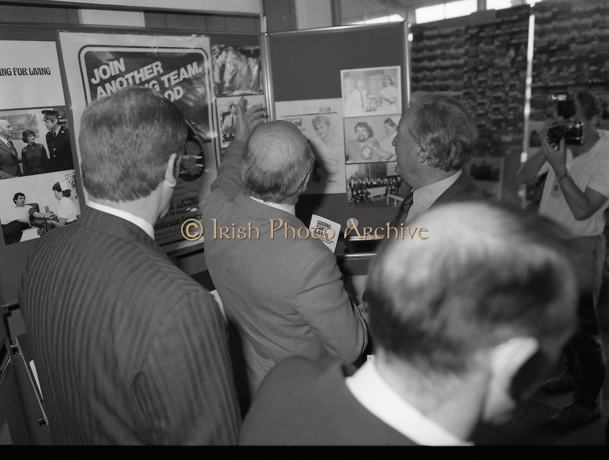 Charles Haughey Visits The Community Games. (T5)..1989..03.10.1989..10.03.1989..3rd September 1989..An Taoiseach, Charles Haughey TD,accompanied by Mr Frank Fahey, TD, Minister of State with responsibility for Youth and Sport attended the Twentieth National Finals of the Community Games at Mosney,  Co.Meath yesterday...Picture shows An Taoiseach, Charles Haughey TD, viewing the Blood Transfusion stand at the community games.