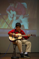 Rafael Vazquez plays Raf's Rhythms - Ode to Joy, Rockin' Robin, Yankee Doodle and a Spanish Song during Holy Trinity School's Talent Show on Tuesday afternoon.  (Karen Bobotas/for the Laconia Daily Sun)