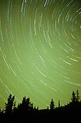 Alaska. Northern lights with star trails.